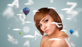 Beautiful young woman with wellness and healthcare clouds. On gradient background stock photography