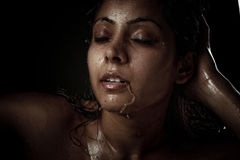Beautiful young woman with wet face Royalty Free Stock Images