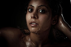 Beautiful young woman with wet face Stock Image