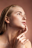 Beautiful young woman with wet face and drops of water Royalty Free Stock Photo