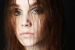 Beautiful young woman with wet hair Stock Photo