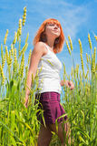 Beautiful young woman at wheat field Stock Photos
