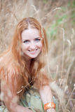 Beautiful young woman in wheat field Stock Photography