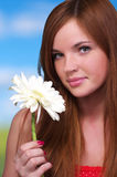 Beautiful young woman with white Royalty Free Stock Image