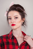 Beautiful young woman on white background in old fashion clothes representing pinup and retro style.  Stock Photography