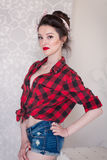 Beautiful young woman on white background in old fashion clothes representing pinup and retro style Royalty Free Stock Photo