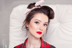 Beautiful young woman on white background in old fashion clothes representing pinup and retro style Stock Images