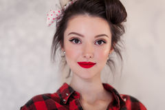 Beautiful young woman on white background in old fashion clothes representing pinup and retro style Royalty Free Stock Image
