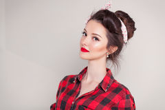 Beautiful young woman on white background in old fashion clothes representing pinup and retro style.  Stock Photos