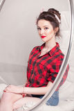 Beautiful young woman on white background in old fashion clothes representing pinup and retro style Stock Photo