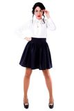 Beautiful young woman in a white blouse and a black skirt Royalty Free Stock Photo
