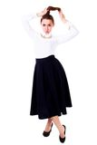 Beautiful young woman in a white blouse and a long black skirt Royalty Free Stock Photo