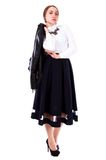 Beautiful young woman in a white blouse and a long black skirt Stock Image