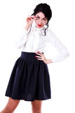 Beautiful young woman in a white blouse and a long blue skirt Royalty Free Stock Images