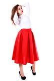 Beautiful young woman in a white blouse and a long red skirt Royalty Free Stock Photos