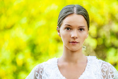 Beautiful young woman in white blouse Stock Photography