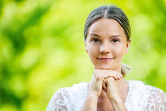 Beautiful young woman in white blouse Royalty Free Stock Photo