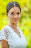 Beautiful young woman in white blouse Royalty Free Stock Images