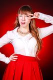 Beautiful young woman in a white chemise and a red skirt Royalty Free Stock Photo