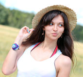 Beautiful young woman in white clothes Stock Images