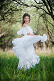 Beautiful young woman in white dress Stock Photography