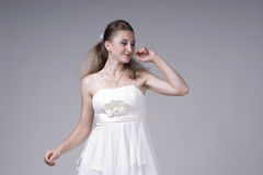 Beautiful young woman in a white dress Royalty Free Stock Images