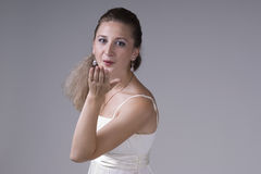 Beautiful young woman in a white dress Stock Images