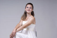 Beautiful young woman in a white dress Stock Photos