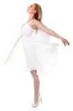 Beautiful young woman in a white dress with angel wings Stock Image