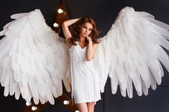 Young woman in white dress with angel wings stock photos