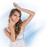 Beautiful young woman in white dress Stock Photos