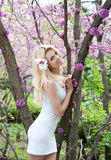 Young woman in white dress in spring park Stock Photography