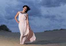 Beautiful young woman with a white dress Stock Photo