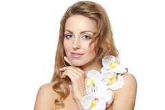 Beautiful young woman with white flower Royalty Free Stock Photos