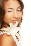 Beautiful young woman with  white flower Royalty Free Stock Image