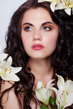 Beautiful young woman with white flowers Royalty Free Stock Images