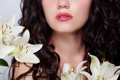 Beautiful young woman with white flowers Stock Images