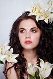 Beautiful young woman with white flowers Royalty Free Stock Image