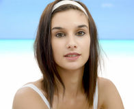 Beautiful young woman with white headband in hair. A beautiful young woman with white headband in hair Royalty Free Stock Photos