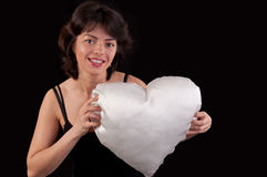 Beautiful young woman with a white heart in hand Stock Photography