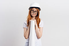 Beautiful young woman on white isolated background holds blueprints, engineer Stock Photos