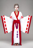 Beautiful young woman in white kimono Royalty Free Stock Photography