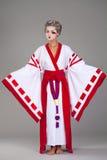 Beautiful young woman in white kimono Stock Photos