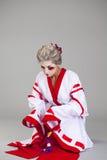 Beautiful young woman in white kimono Stock Image