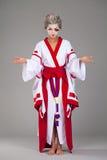 Beautiful young woman in white kimono Stock Photo