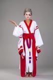 Beautiful young woman in white kimono Royalty Free Stock Photo