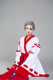 Beautiful young woman in white kimono Royalty Free Stock Image