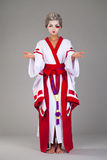 Beautiful young woman in white kimono Stock Images