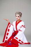 Beautiful young woman in white kimono Stock Photography
