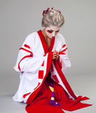 Beautiful young woman in white kimono Royalty Free Stock Images